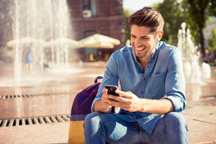 Guy Happily Texting